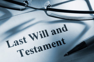 Last Will and Testament with reading glasses and pen