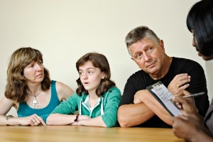An upset family talking with a Family Law Attorney in East Peoria IL